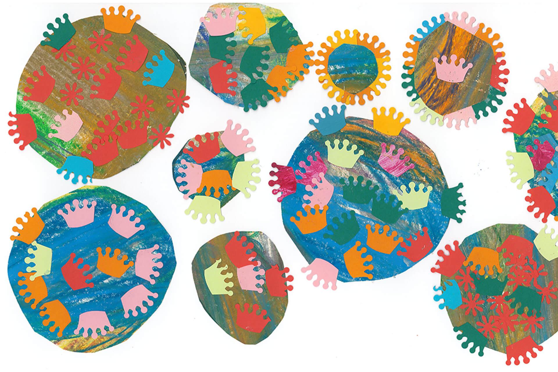 Krönchen aus Pappe gestanzt werden zweckentfremdet und als die Spike-Proteine des Virus an bunte Kreise geklebt.